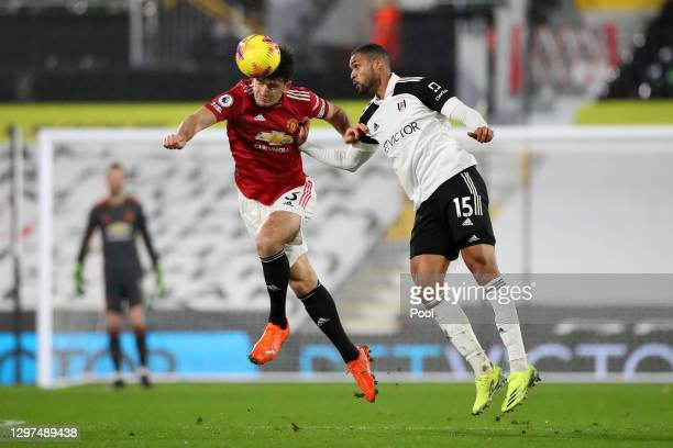 Harry Maguire of Manchester United heads the ball away from Ruben Loftus-Cheek of Fulham during the Premier League match between Fulham and...