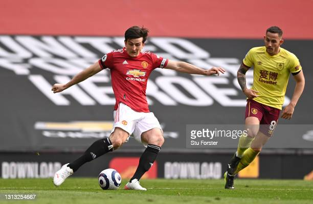 Harry Maguire of Manchester United in action during the Premier League match between Manchester United and Burnley at Old Trafford on April 18, 2021...