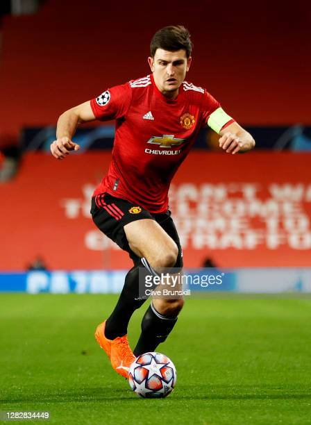 Harry Maguire of Manchester United in action during the UEFA Champions League Group H stage match between Manchester United and RB Leipzig at Old...
