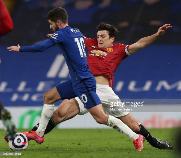 Harry Maguire of Manchester United in action with Christian Pulisic of Chelsea during the Premier League match between Chelsea and Manchester United...