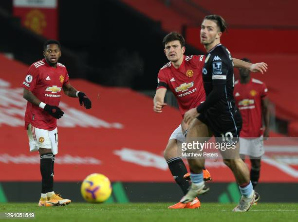Harry Maguire of Manchester United in action with Jack Grealish of Aston Villa during the Premier League match between Manchester United and Aston...