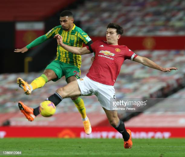 Harry Maguire of Manchester United in action with Karlan Grant of West Bromwich Albion during the Premier League match between Manchester United and...