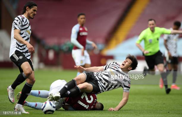 Harry Maguire of Manchester United is challenged by Anwar El Ghazi of Aston Villa during the Premier League match between Aston Villa and Manchester...