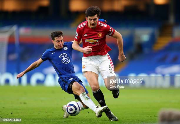 Harry Maguire of Manchester United is challenged by Cesar Azpilicueta of Chelsea during the Premier League match between Chelsea and Manchester...