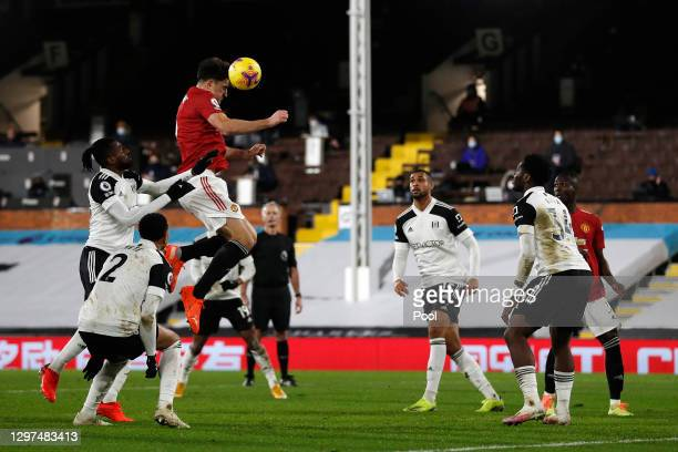 Harry Maguire of Manchester United jumps for a header during the Premier League match between Fulham and Manchester United at Craven Cottage on...
