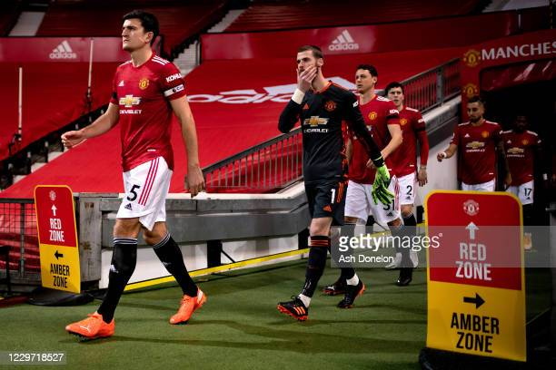 Harry Maguire of Manchester United leads out his teammates to the pitch prior to the Premier League match between Manchester United and West Bromwich...