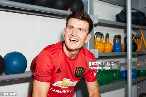 Harry Maguire of Manchester United looks around the Aon Training Complex after signing for the club at Aon Training Complex on August 04 2019 in...