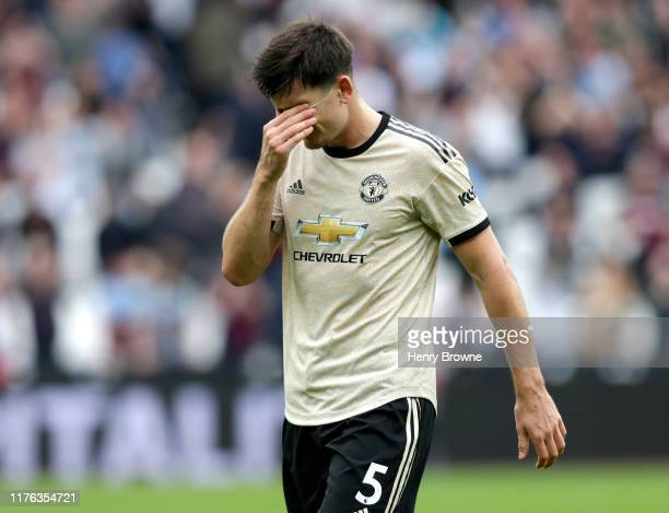 Harry Maguire of Manchester United looks dejected following his sides defeat in during the Premier League match between West Ham United and...