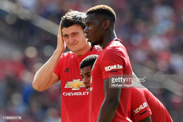 Harry Maguire of Manchester United looks dejected with team mate Paul Pogba during the Premier League match between Manchester United and Crystal...