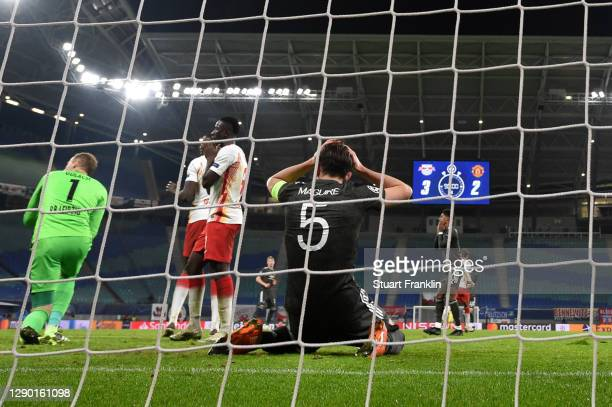 Harry Maguire of Manchester United reacts after missing a goal scoring chance during the UEFA Champions League Group H stage match between RB Leipzig...