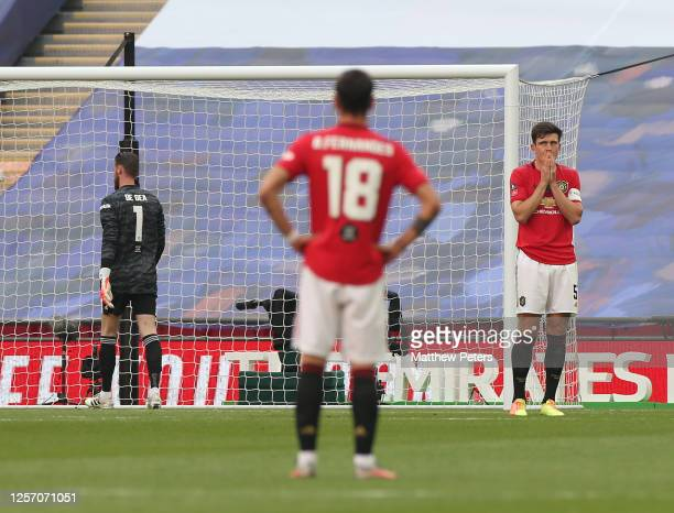 Harry Maguire of Manchester United reacts to conceding a goal to Mason Mount of Chelsea during the FA Cup Semi Final match between Manchester United...