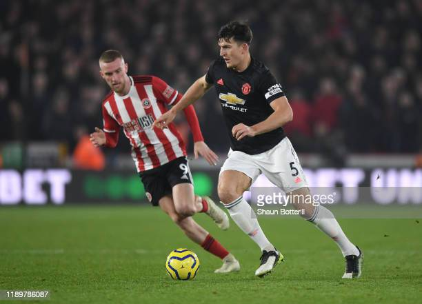 Harry Maguire of Manchester United runs with the ball during the Premier League match between Sheffield United and Manchester United at Bramall Lane...