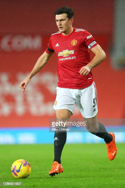Harry Maguire of Manchester United runs with the ball during the Premier League match between Manchester United and West Bromwich Albion at Old...