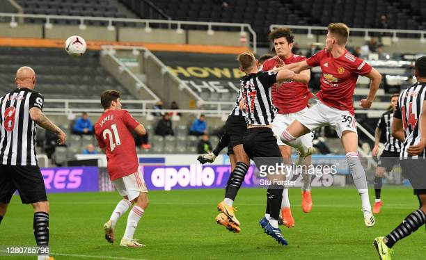 Harry Maguire of Manchester United scores his team's first goal during the Premier League match between Newcastle United and Manchester United at St....