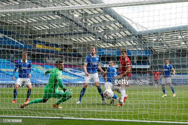 Harry Maguire of Manchester United scores his team's first goal past Mat Ryan of Brighton and Hove Albion during the Premier League match between...