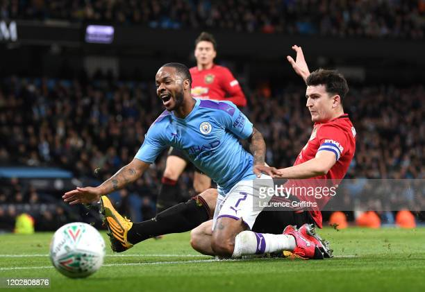 Harry Maguire of Manchester United tackles Raheem Sterling of Manchester City during the Carabao Cup Semi Final match between Manchester City and...