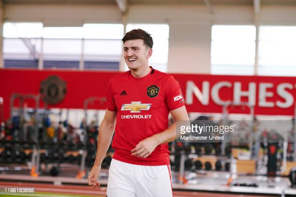 Harry Maguire of Manchester United walks around the Aon Training Complex after signing for the club at Aon Training Complex on August 04, 2019 in...