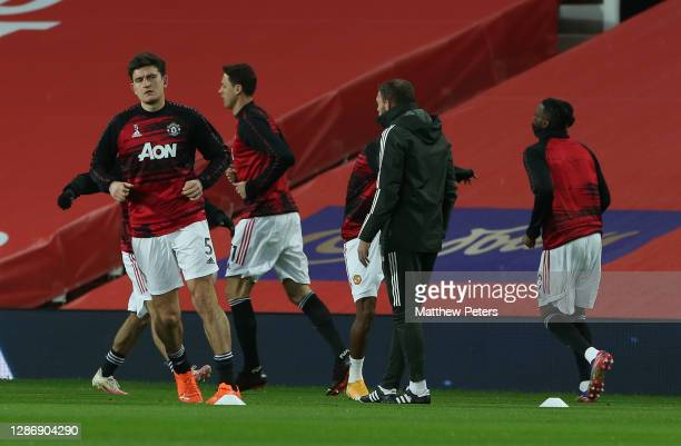 Harry Maguire of Manchester United warms up ahead of the Premier League match between Manchester United and West Bromwich Albion at Old Trafford on...