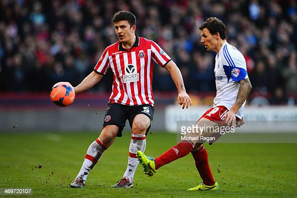 Harry Maguire of Sheffield United and Darius Henderson of Nottingham Forest challenge for the ball during the FA Cup Fifth Round match between...