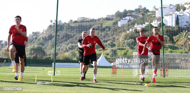 Harry Maguire, Phil Jones and Andreas Pereira of Manchester United in action during a first team training session on February 10, 2020 in Malaga,...