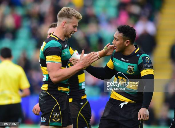 Harry Mallinder and Nafi Tuitavake of Northampton Saints celebrate their win during Champions Cup Playoff match between Northampton Saints and...