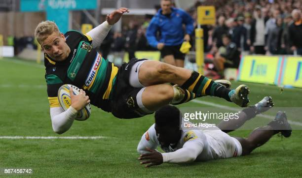 Harry Mallinder of Northampton dives over for a try during the Aviva Premiership match between Northampton Saints and Wasps at Franklin's Gardens on...