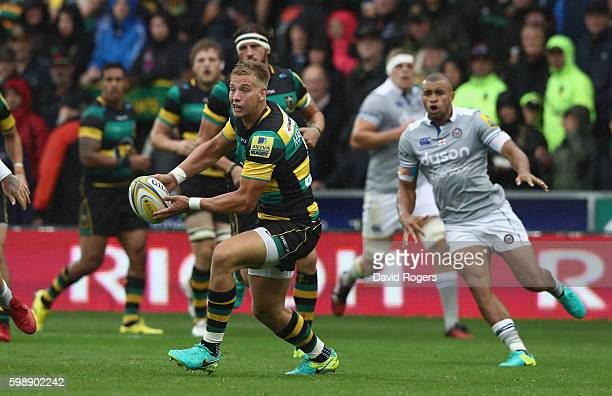 Harry Mallinder of Northampton passes the ball during the Aviva Premiership match between Northampton Saints and Bath at Franklin's Gardens on...