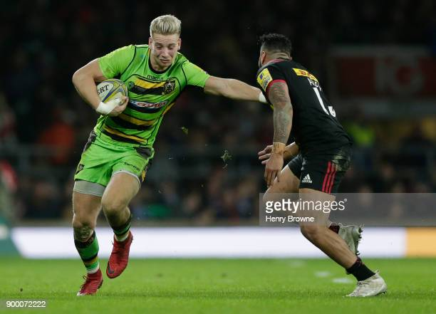 Harry Mallinder of Northampton Saints and Alofa Alofa of Harlequins during the Aviva Premiership Big Game 10 match between Harlequins and Northampton...
