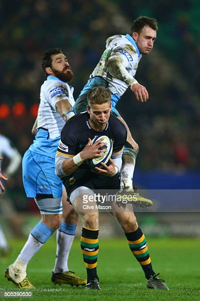 Harry Mallinder of Northampton Saints claims a high ball under pressure from Stuart Hogg of Glasgow Warriors during the European Rugby Champions Cup...