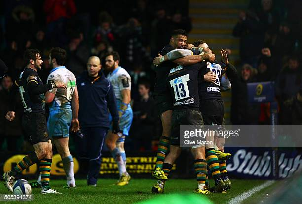 Harry Mallinder of Northampton Saints is congratulated by teammates after scoring the matchwinning try on the stroke of fulltime during the European...