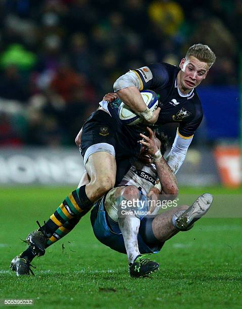 Harry Mallinder of Northampton Saints is tackled by Alex Dunbar of Glasgow Warriors during the European Rugby Champions Cup pool three match between...