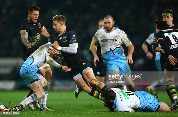 Harry Mallinder of Northampton Saints is tackled by Finn Russell and Sean Lamont of Glasgow Warriors during the European Rugby Champions Cup pool...