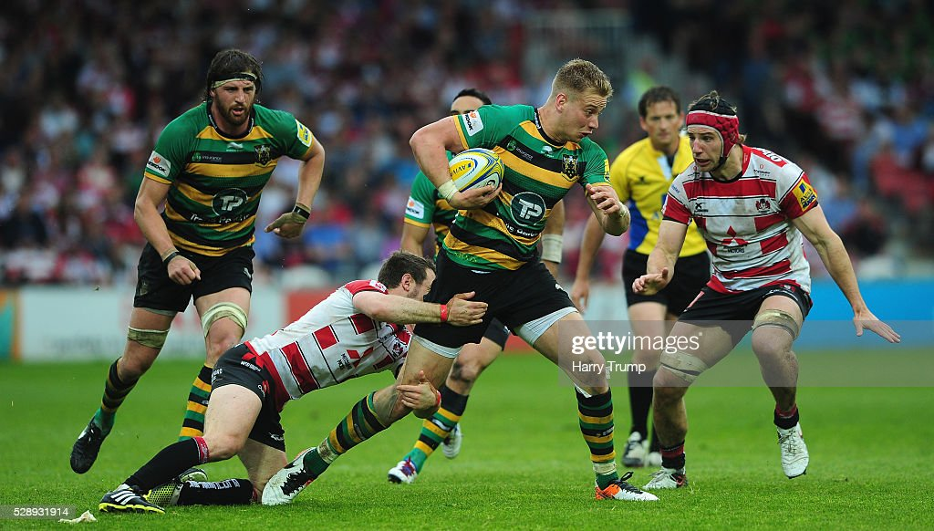 Harry Mallinder of Northampton Saints is tackled by Greig Laidlaw of Gloucester Rugby during the Aviva Premiership match between Gloucester Rugby and Northampton Saints at Kingsholm on May 07, 2016 in Gloucester, England.
