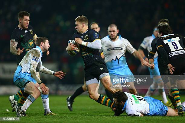 Harry Mallinder of Northampton Saints is tackled by Sean Lamont of Glasgow Warriors during the European Rugby Champions Cup pool three match between...
