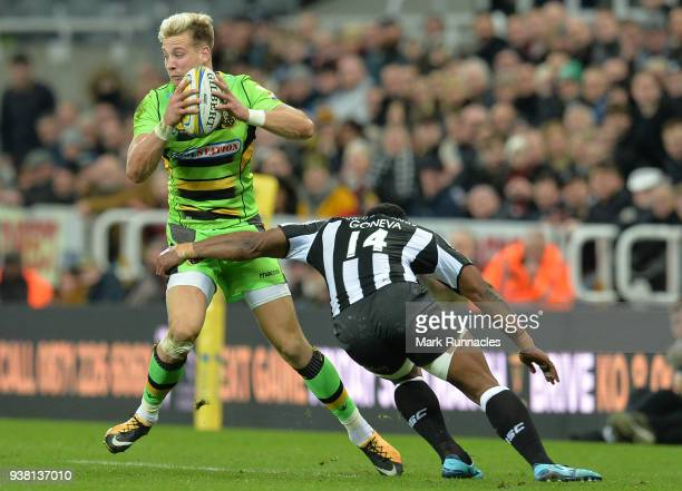 Harry Mallinder of Northampton Saints is tackled by Vereniki Goneva of Newcastle Falcons during the Aviva Premiership match between Newcastle Falcons...