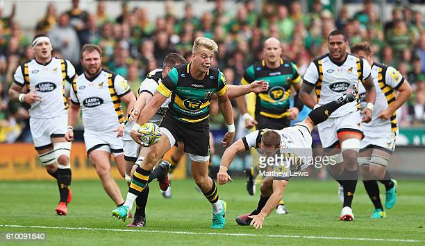 Harry Mallinder of Northampton Saints makes a break through the Wasps defence during the Aviva Premiership match between Northampton Saints and Wasps...