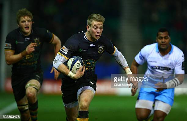 Harry Mallinder of Northampton Saints runs with the ball during the European Rugby Champions Cup pool three match between Northampton Saints and...