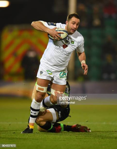 Harry Mallinder of Northampton Saints tackles Alexandre Lapandry of ASM Clermont Auvergne during the European Rugby Champions Cup match between...