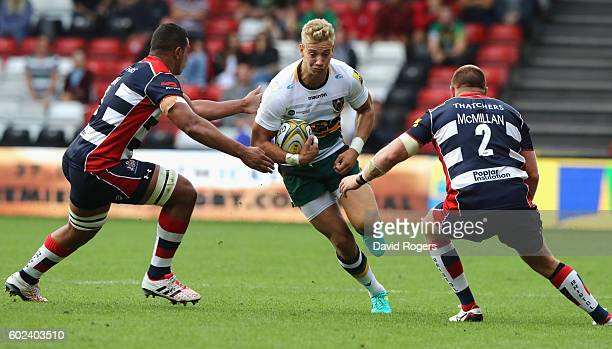 Harry Mallinder of Northampton takes on Ben Glynn and Ross McMillan during the Aviva Premiership match between Bristol and Northampton Saints at...
