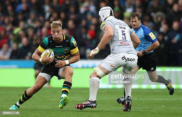 Harry Mallinder of Northampton takes on Dave Attwood during the Aviva Premiership match between Northampton Saints and Bath at Franklin's Gardens on...