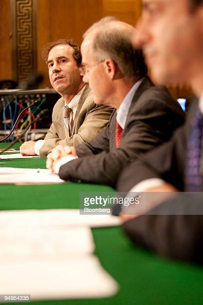 Harry Markopolos an independent financial fraud investigator and former money manager left speaks during a hearing of the Senate Banking Committee...
