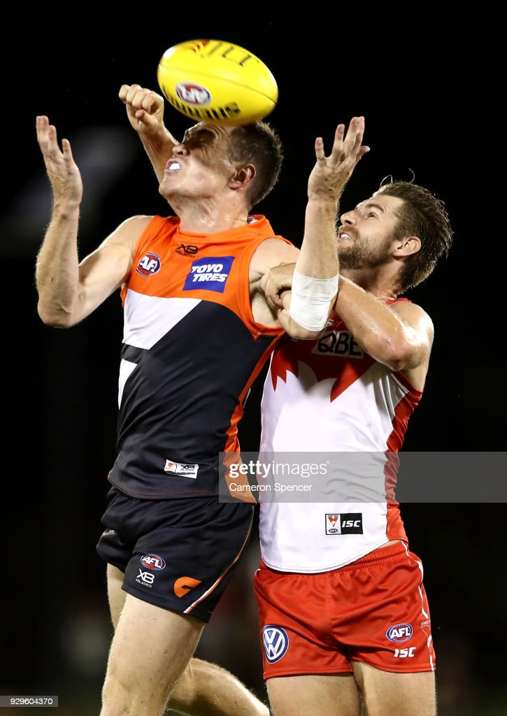 Harry Marsh of the Swans spoils the ball behind Jeremy Cameron of the Giants during the JLT Community Series AFL match between the Sydney Swans and the Greater Western Sydney Giants at Blacktown International Sportspark on March 9, 2018 in Sydney, Australia.