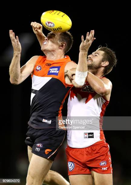 Harry Marsh of the Swans spoils the ball behind Jeremy Cameron of the Giants during the JLT Community Series AFL match between the Sydney Swans and...