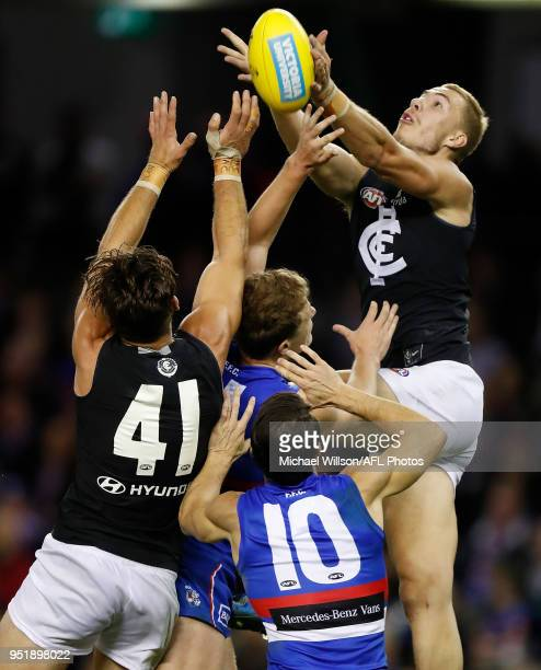 Harry McKay of the Blues and Levi Casboult of the Blues compete for the ball against Easton Wood of the Bulldogs during the 2018 AFL round six match...