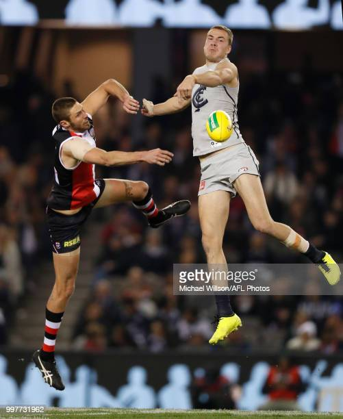 Harry McKay of the Blues and Tom Hickey of the Saints compete in a ruck contest during the 2018 AFL round 17 match between the St Kilda Saints and...