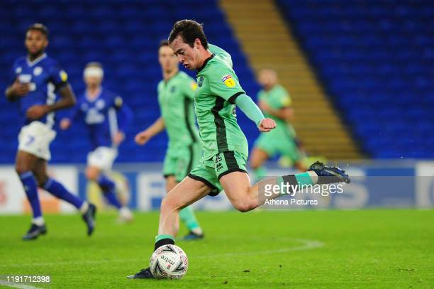 Harry McKirdy of Carlisle United has a shot during the FA Cup third round match between Cardiff City and Carlisle United at the Cardiff City Stadium...