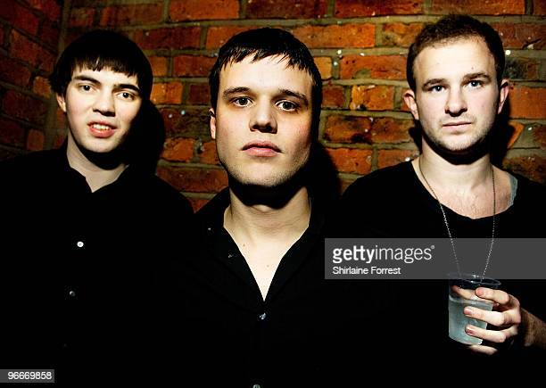 Harry McVeigh Charles Cave and Jack LawrenceBrown of White Lies pose backstage before performing at FAC 251 on February 13 2010 in Manchester England