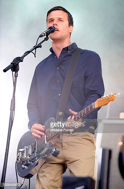 Harry McVeigh of White Lies performs at day two of V Festival at Weston Park on August 22 2010 in Stafford England