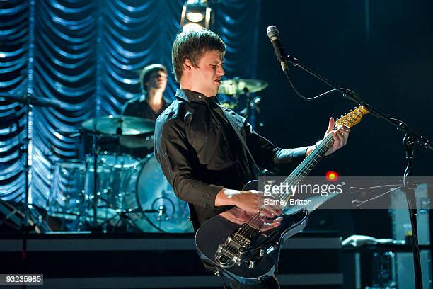 Harry McVeigh of White Lies performs on stage at Brixton Academy on November 19 2009 in London England