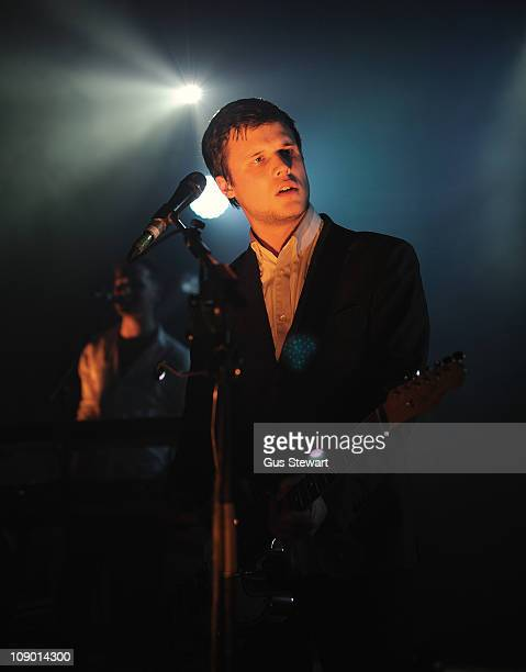 Harry McVeigh of White Lies performs on stage at Shepherds Bush Empire on February 11 2011 in London England